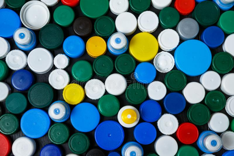 Collection of various colorful plastic caps. Conception of plastic processing for ecology or charity. Collection of various colorful plastic caps. Useful as stock photography