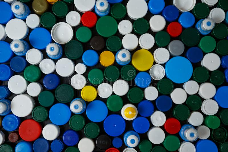 Collection of various colorful plastic caps. Conception of plastic processing for ecology or charity. Collection of various colorful plastic caps. Useful as stock photo