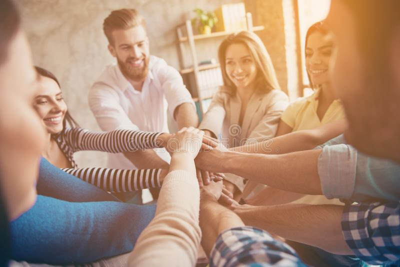 Conception of successful teambuilding. Cropped close up photo of royalty free stock photos