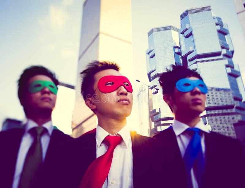 Concepto asiático de la ciudad de los super héroes de los hombres de negocios foto de archivo libre de regalías