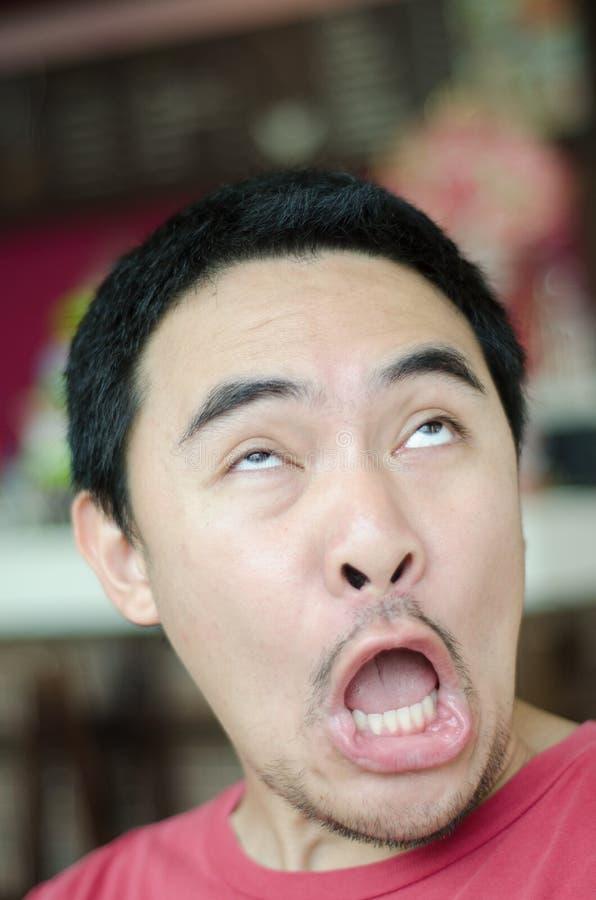 Concepto asombrosamente de la cara del hombre asiático fotos de archivo libres de regalías