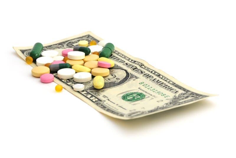 """Concepto barato de las drogas del †de las píldoras y del dinero """" imagen de archivo libre de regalías"""