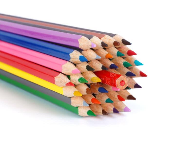 Concepto coloreado de los lápices - oposición a la mayoría foto de archivo libre de regalías