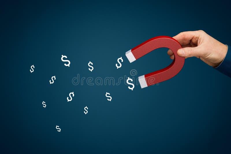 Concepto de éxito financiero - imán para el dinero imágenes de archivo libres de regalías