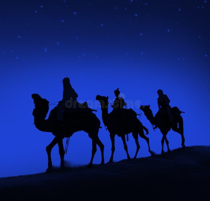 Concepto de Belén del desierto del viaje del camello de tres hombres sabios fotografía de archivo libre de regalías