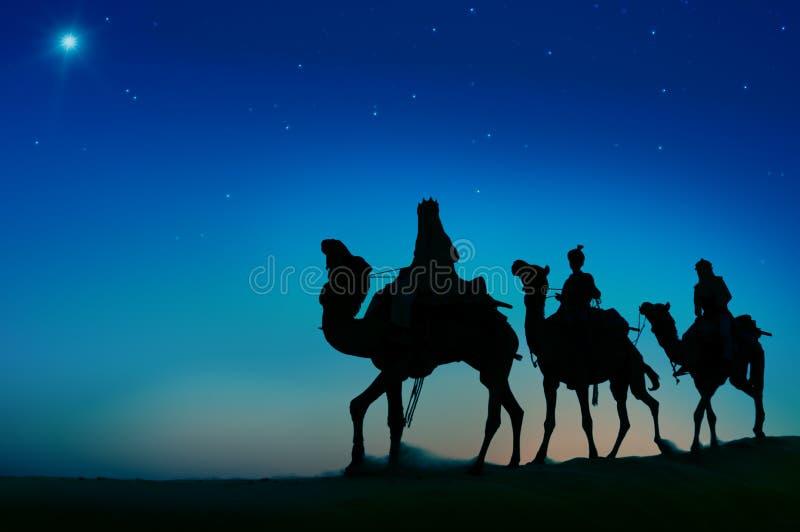 Concepto de Belén del desierto del viaje del camello de tres hombres sabios fotos de archivo