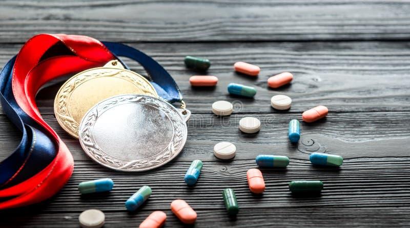 Concepto de doping en el deporte - medallas de la privación imágenes de archivo libres de regalías