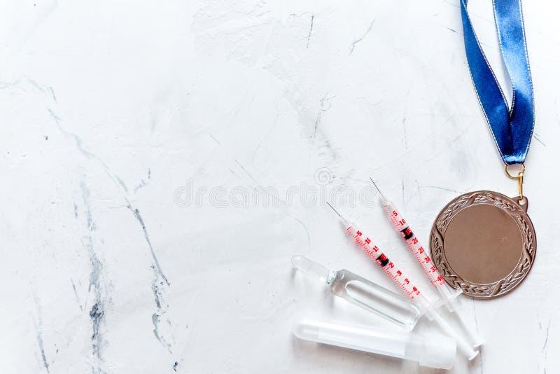 Concepto de doping en el deporte - opinión superior de las medallas de la privación fotos de archivo