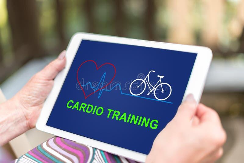 Concepto de entrenamiento cardiio en una tableta foto de archivo