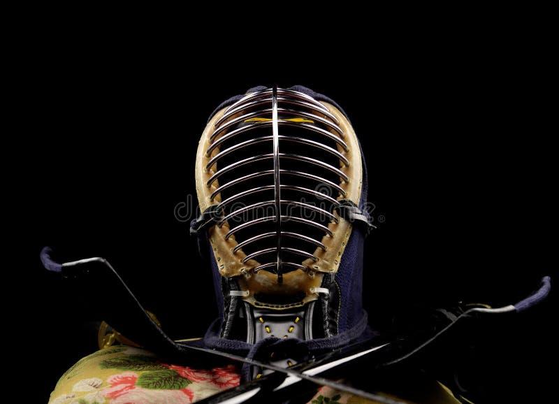 Concepto de Kendo sobre fondo negro foto de archivo