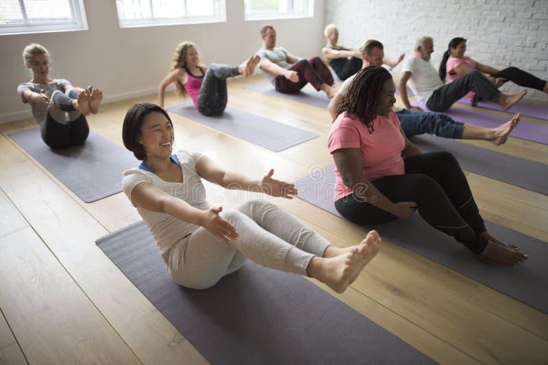 Concepto de la clase de la yoga fotografía de archivo libre de regalías
