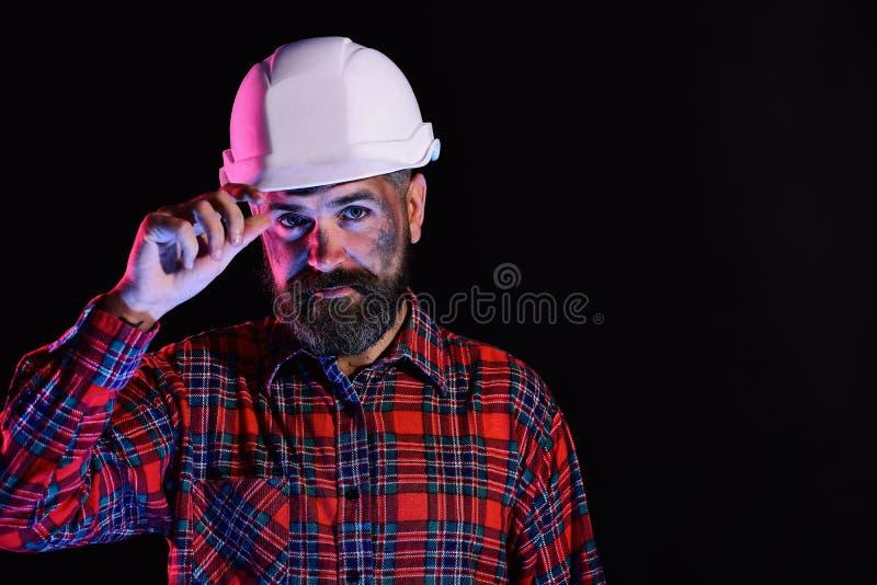 Concepto de la construcción y del trabajo duro Trabajador con imagen brutal imagen de archivo
