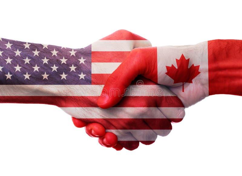 Concepto de la cooperación del apretón de manos de los E.E.U.U. Canadá imagen de archivo