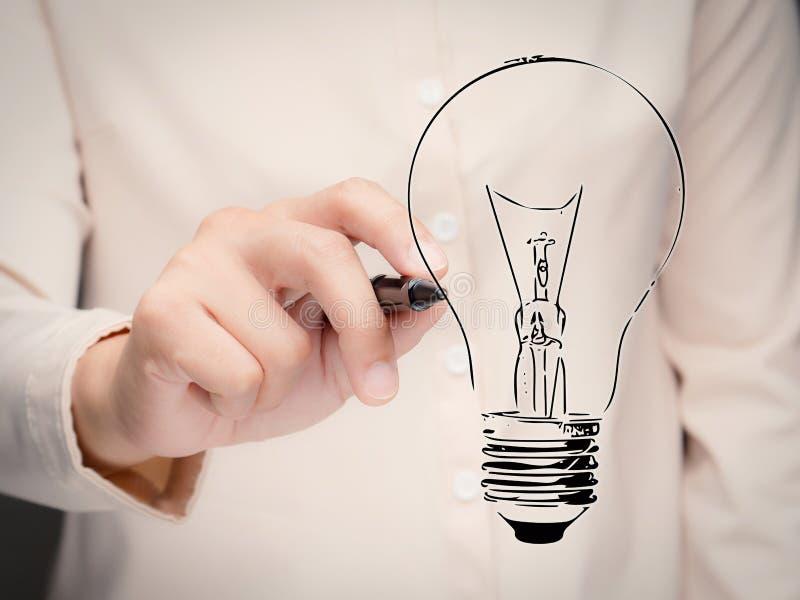 Concepto de la creatividad con la bombilla del dibujo de la mano fotos de archivo libres de regalías
