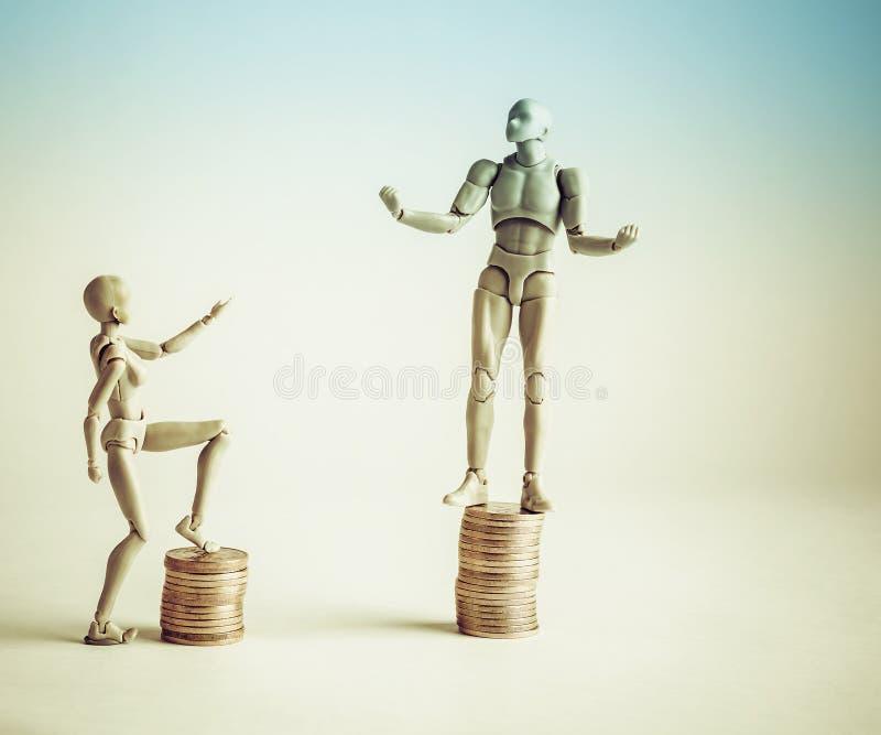 Concepto de la desigualdad de la renta mostrado con el varón realista y f femenina fotografía de archivo libre de regalías