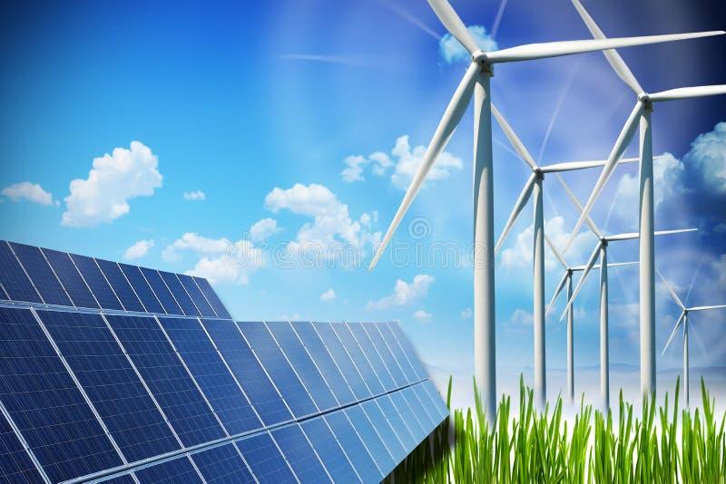Concepto de la energía renovable con los paneles solares y las turbinas de viento en campo verde imagen de archivo libre de regalías