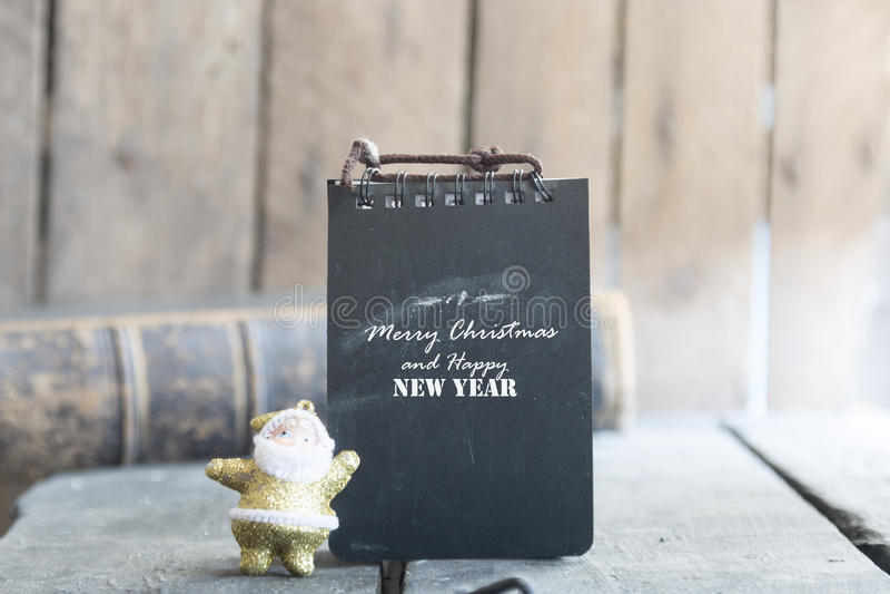 Concepto de la Feliz Navidad y de la Feliz Año Nuevo para la tarjeta de la invitación o de felicitación imagenes de archivo