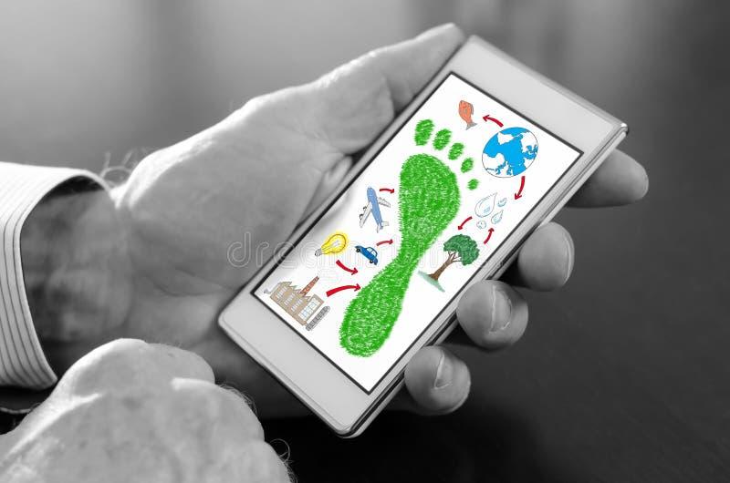 Concepto de la huella del carbono en un smartphone ilustración del vector