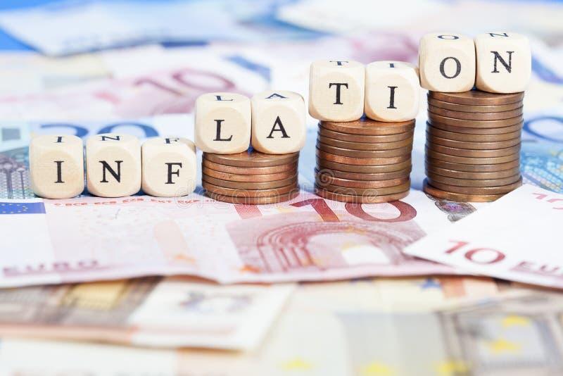 Concepto de la inflación con el dinero euro imagen de archivo libre de regalías