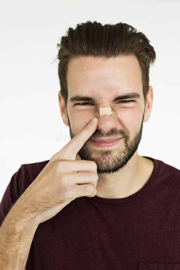 Concepto de la nariz del yeso del vendaje de los hombres foto de archivo libre de regalías