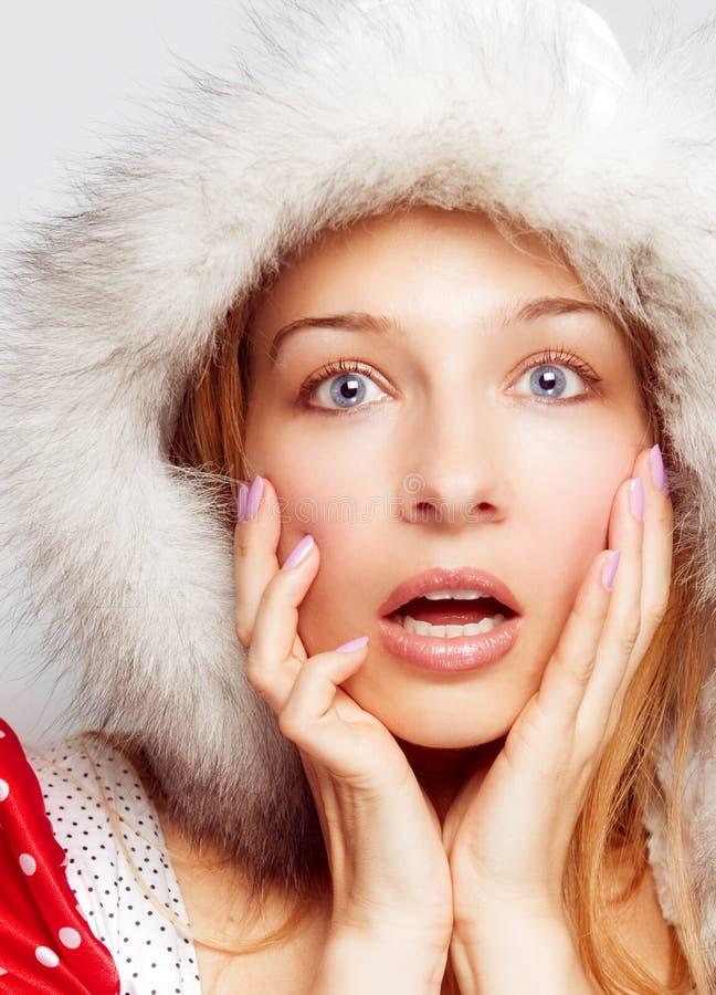 Concepto de la Navidad de la sorpresa - una mujer sorprendente imágenes de archivo libres de regalías