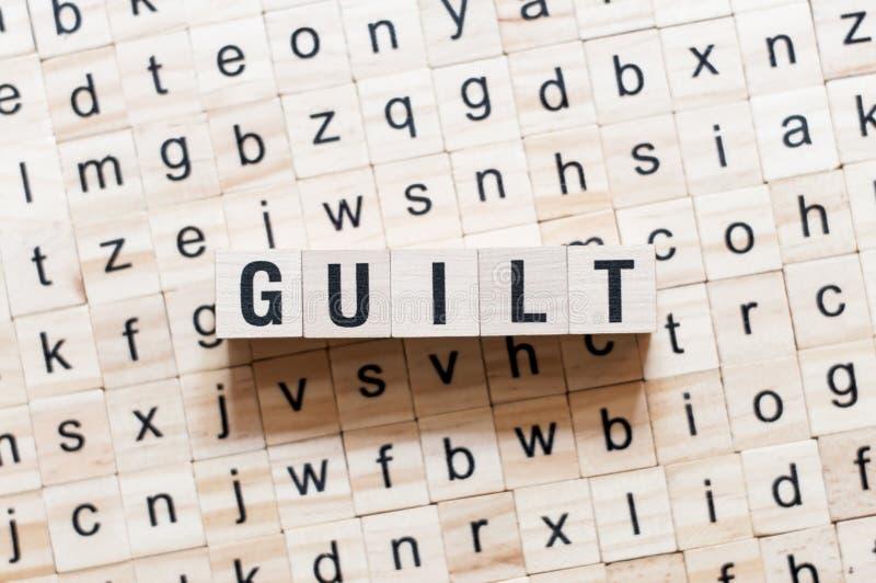 Concepto de la palabra de la culpabilidad en los cubos fotos de archivo