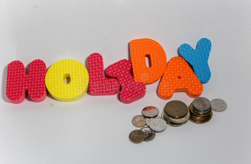 Concepto de la palabra del día de fiesta con la moneda en el fondo blanco imagen de archivo libre de regalías