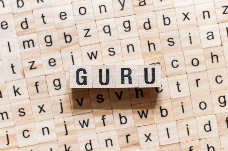 Concepto de la palabra de Guru en los cubos imagenes de archivo