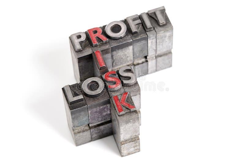 Concepto de la prensa de copiar de la pérdida y del riesgo del beneficio fotos de archivo libres de regalías