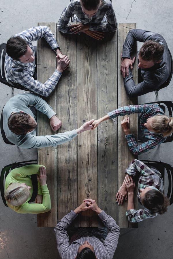Concepto de la reunión del trabajo en equipo fotos de archivo