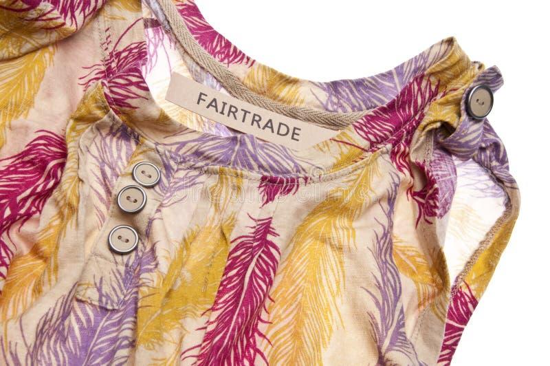 Concepto de la ropa del comercio justo imagenes de archivo
