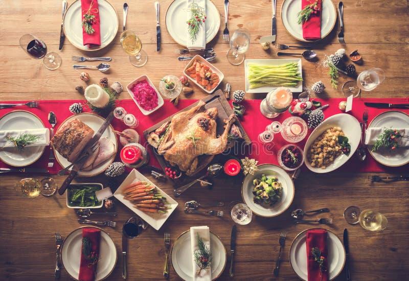 Concepto de la tabla de cena de la familia de la Navidad imagenes de archivo