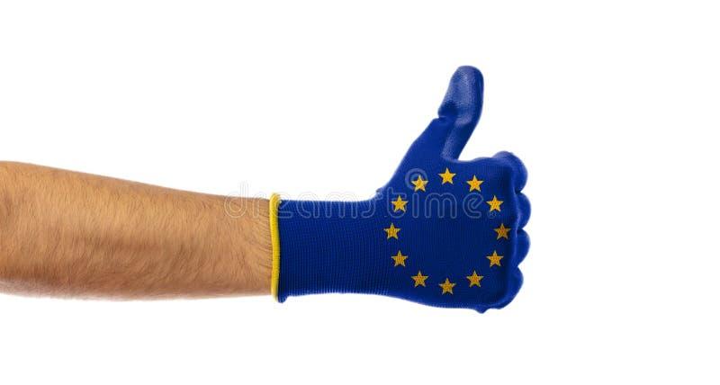 Concepto de la victoria de la UE Manosee con los dedos para arriba, guante de la bandera de unión europea aislado en el fondo bla imagen de archivo