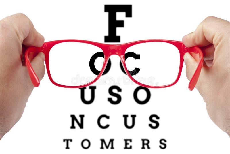 Concepto de las gafas de los clientes del cliente del foco fotografía de archivo libre de regalías