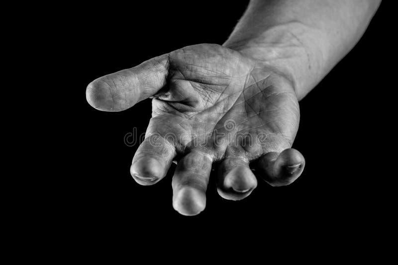 Concepto de las manos amigas Mano de una palma del hombre encima de alcanzar, de dar, de pedir o de llevar a cabo algo imagen de archivo libre de regalías