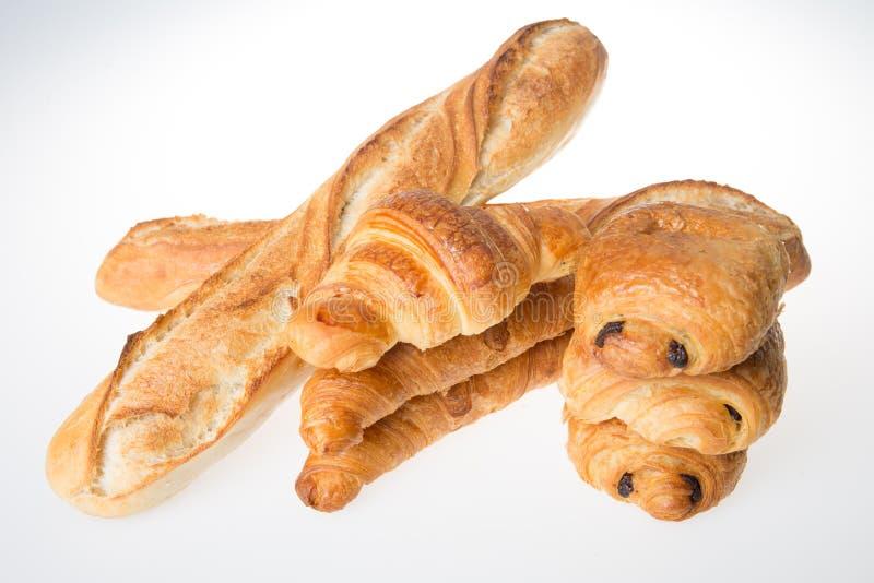 Concepto de los chocolates de los cruasanes y de los panes de los Baguettes de panadería francesa fotografía de archivo libre de regalías