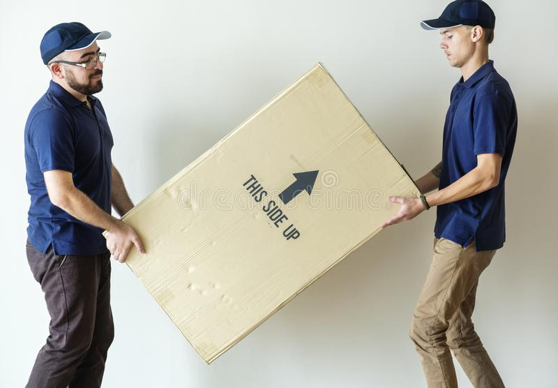 Concepto de los trabajadores del servicio de entrega de los muebles fotografía de archivo libre de regalías