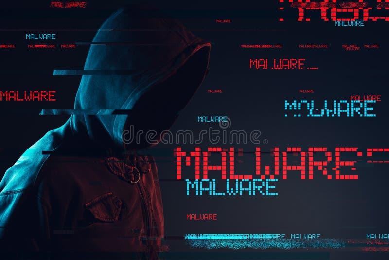 Concepto de Malware con la persona masculina encapuchada anónima fotografía de archivo