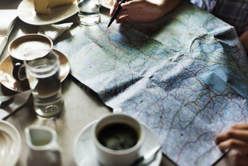Concepto de Person Choosing Destination On Map foto de archivo