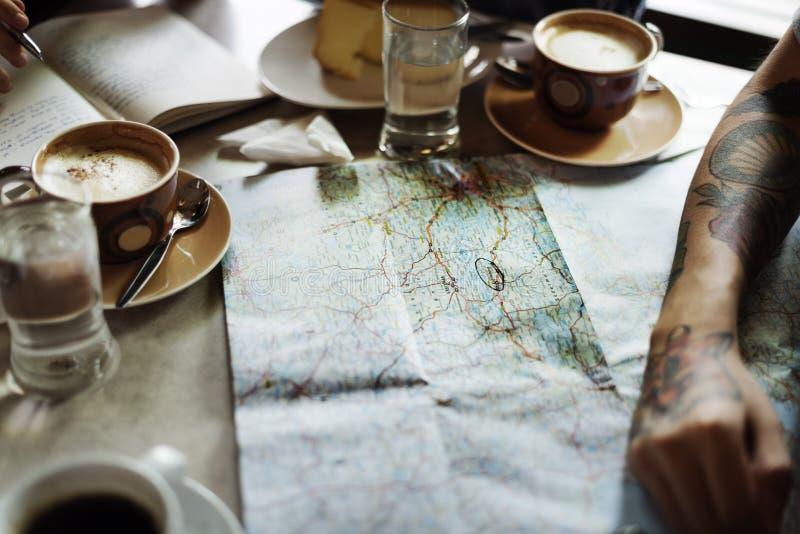 Concepto de Person Choosing Destination On Map imagen de archivo libre de regalías