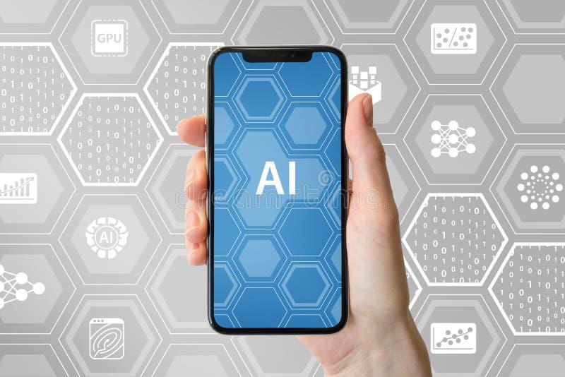 Concepto del AI/de la inteligencia artificial Dé sostener smartphone frameless moderno delante del fondo neutral con los iconos foto de archivo libre de regalías