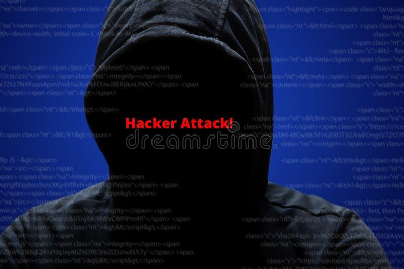 Concepto del ataque del pirata informático El pirata informático de sexo masculino misterioso anónimo irreconocible en sudadera c imagen de archivo libre de regalías