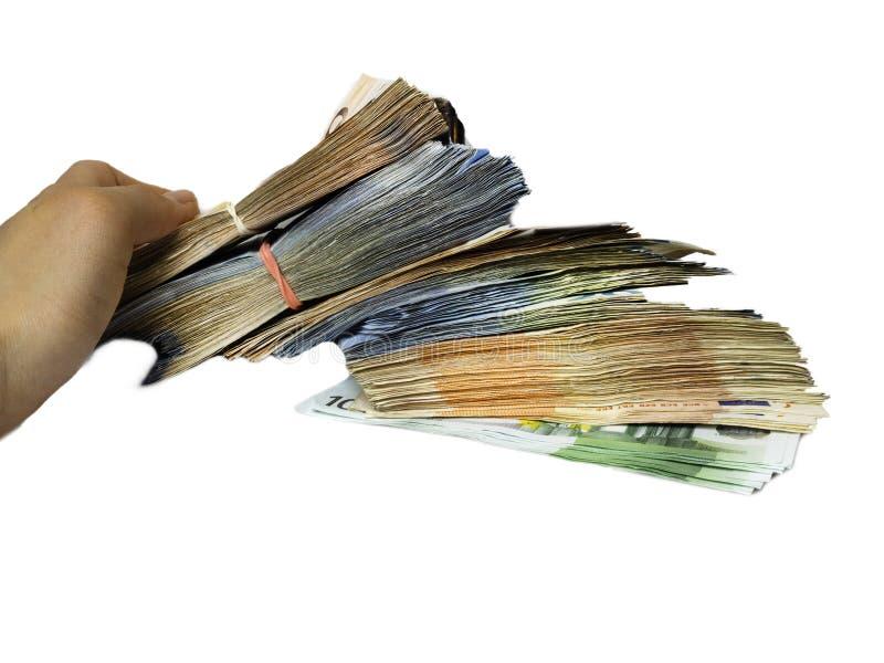 Concepto del beneficio y de la riqueza porción que se sostiene humana de dinero a disposición, fondo blanco Rico, acertado, efect foto de archivo libre de regalías
