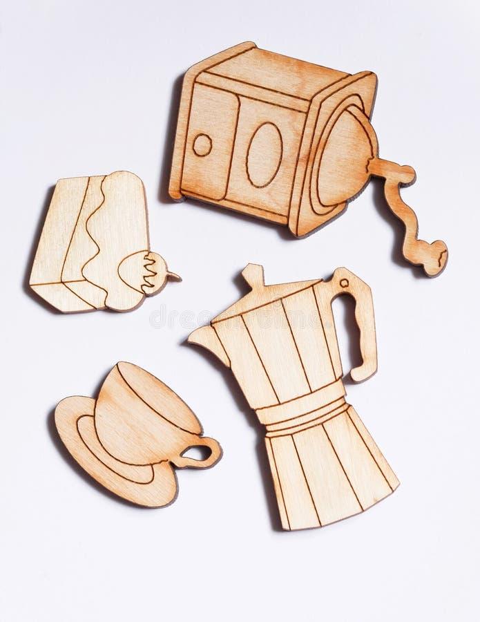 Concepto del café con la amoladora, la taza y un pedazo de torta foto de archivo libre de regalías