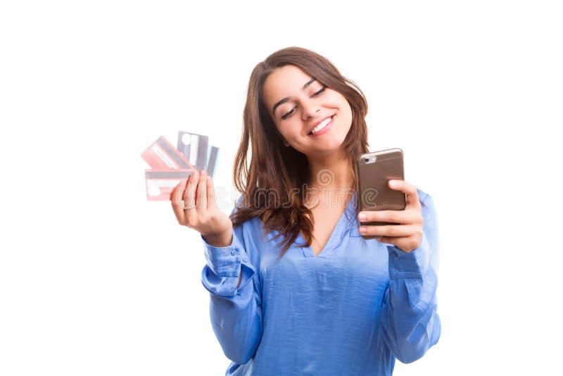 Concepto del comercio electrónico - compras de la mujer fotos de archivo