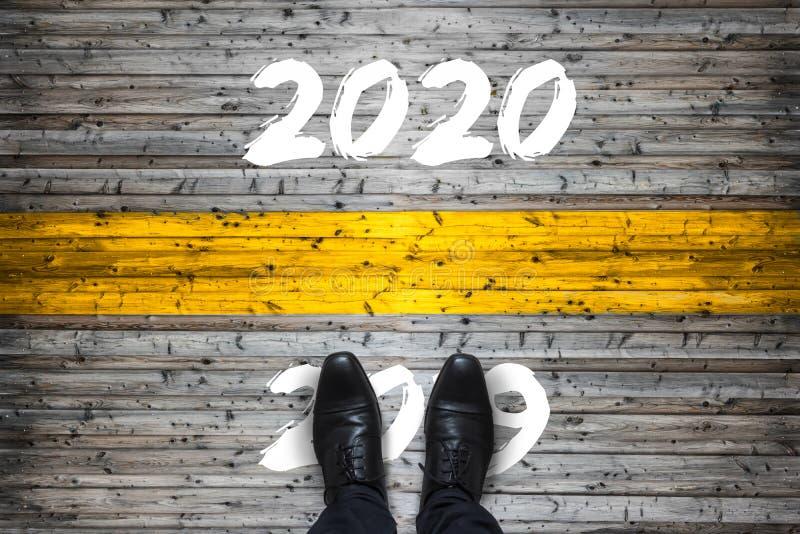 Concepto del comienzo de la recepción 2020 - adiós 2019 - imagenes de archivo