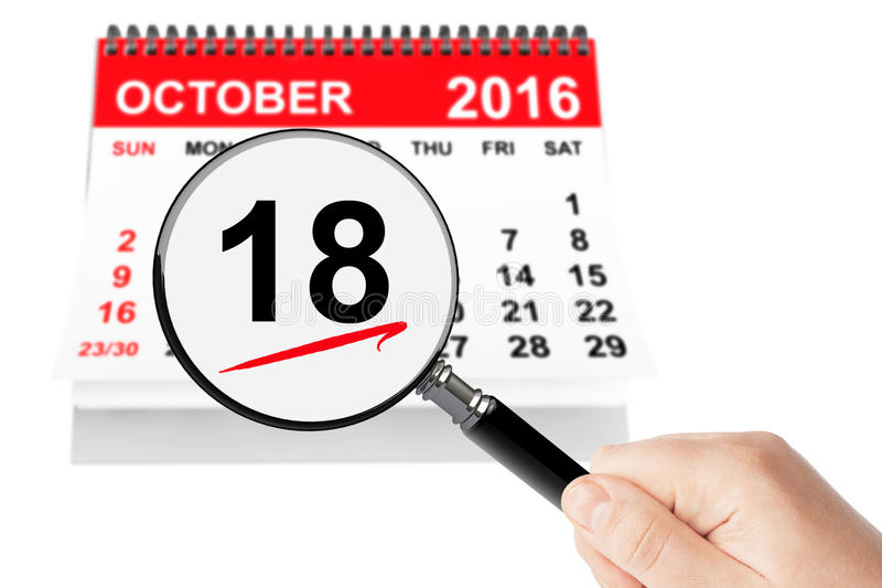 Concepto del día de Alaska 18 de octubre de 2016 calendario con la lupa fotos de archivo libres de regalías