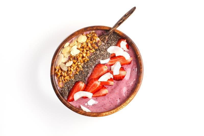 Concepto del desayuno del vegano Cuenco del smoothie de la fresa con las almendras, fotografía de archivo