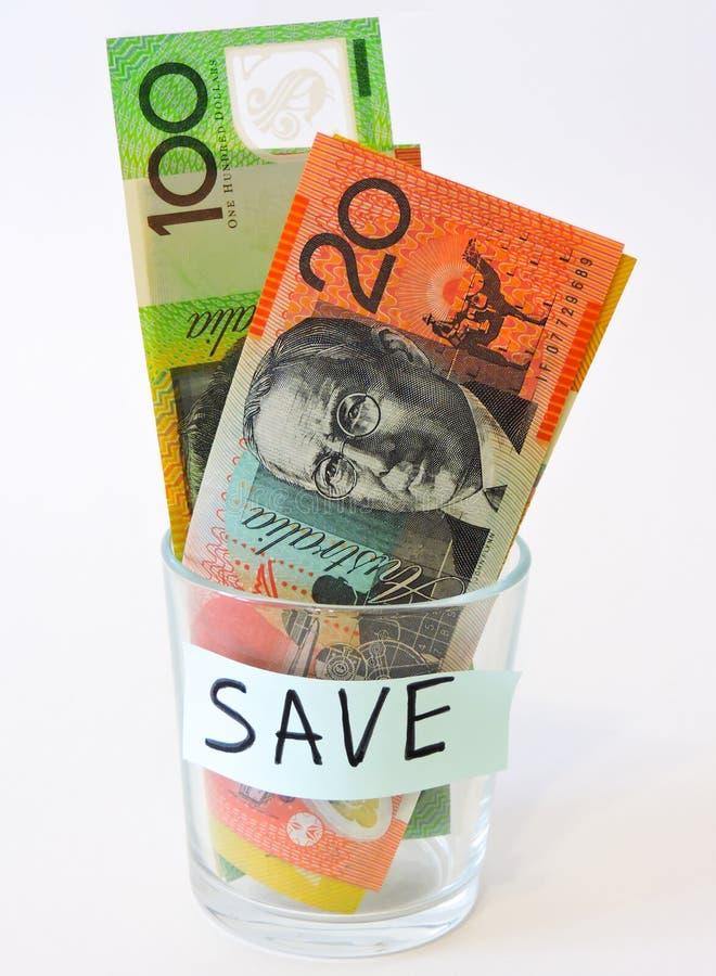 Concepto del dinero del ahorro Tarros de cristal con los d?lares y el texto: VIAJE Monedas en el tarro de cristal para el dinero  foto de archivo libre de regalías