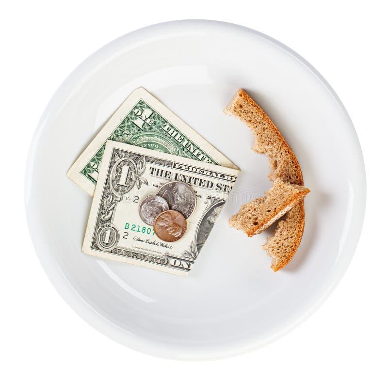 Concepto del dinero en circulación del dólar de la crisis de la economía con pan fotos de archivo
